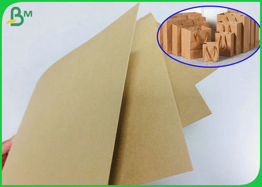 300gr 350gr 400gr alisan el rollo superficial del papel de Brown Kraft en paquete del carrete